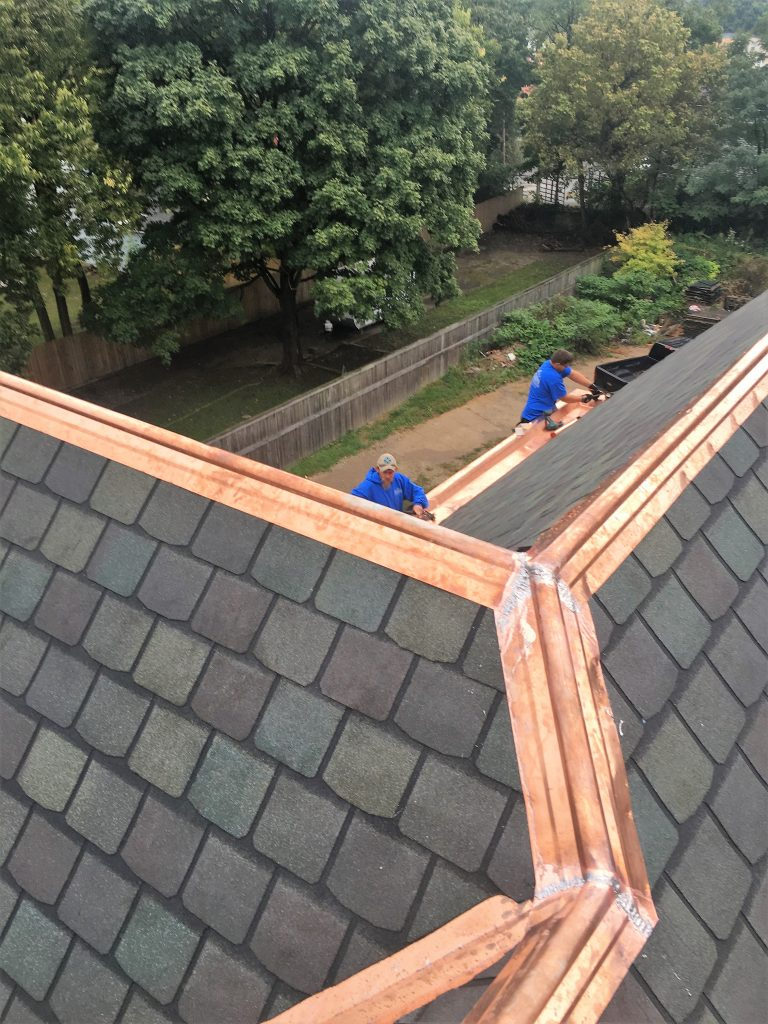 designer roof replacement